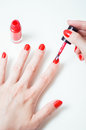 Young woman is painting her nails Royalty Free Stock Photo