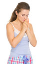 Young woman in pajamas praying before sleep Stock Photos