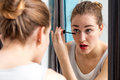 Young woman pampering her eyes with mascara for beauty routine Royalty Free Stock Photo