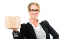 Young woman with a parcel in front of white background she ship package or would send packet symbol for logistics Stock Photo