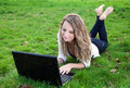 Young woman in park with laptop Royalty Free Stock Images
