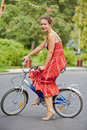 Young woman participant of cycle parade lady on bike Royalty Free Stock Images