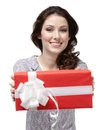 Young woman passes a present Stock Photos