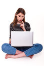 Young woman with pc hand on chin e commerce stock image she is looking at laptop screen Royalty Free Stock Image