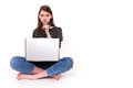 Young woman with pc hand on chin e commerce stock image she is looking at laptop screen Royalty Free Stock Photos