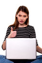 Young woman with pc thumbs up e commerce security stock image she is looking at camera Stock Photography