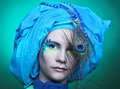 Young woman with peacock feathers Royalty Free Stock Photo