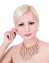 Young woman with pearl necklace and earrings Royalty Free Stock Images
