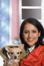 Young woman with pet chihuahua Royalty Free Stock Photo