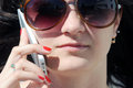 Young woman phoning in a sunny day Stock Photography