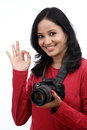 Young woman photographer making ok sign against white Stock Image