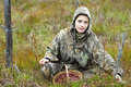 Young woman pick cranberry on a bog. Royalty Free Stock Photo