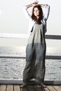 Young woman on the pier full length in morning summer holiday Royalty Free Stock Photography