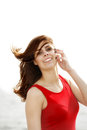 Young woman on the pier wind in hair red dress morning summer holiday Royalty Free Stock Photos