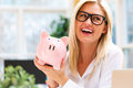 Young woman with a piggy bank Royalty Free Stock Photo