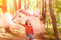Young woman with pink color smoke bomb Royalty Free Stock Photo