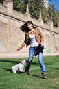 Young woman playing with dog a in park Royalty Free Stock Photography