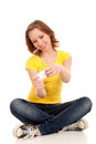Young woman playing games on smartphone Royalty Free Stock Photography