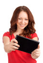 Young woman playing games tablet studio shot over white background Stock Photography