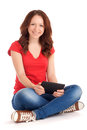 Young woman playing games tablet studio shot over white background Royalty Free Stock Photos