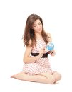 Young woman playing with a globe Royalty Free Stock Photography
