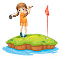 A young woman playing golf Royalty Free Stock Photo