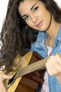 Young woman playing guitar in studio Royalty Free Stock Images