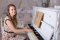 Young woman playing the piano beautiful Stock Photo