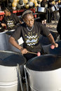 A young woman playing steel drums Stock Images