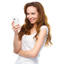 Young woman is pleased by incoming message cheerful on her phone isolated over white Stock Photo