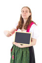 Young woman pointing at blank blackboard in dirndl Stock Photography