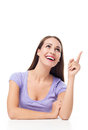 Young woman pointing finger casual over white background Royalty Free Stock Image