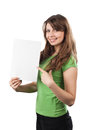 Young woman pointing at a white sign smiling showing isolated on Royalty Free Stock Images