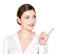 Young woman points to side white shirt isolated white background Royalty Free Stock Images