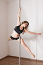 Young woman pole dancing Royalty Free Stock Image