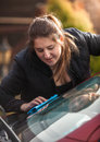 Young woman polishing windscreen closeup portrait of Stock Photo