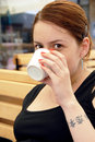 Young woman portrait drinking coffee caucasian brunette with cup in hand Royalty Free Stock Photo