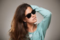 Young woman portrait with fashion sunglasses beautiful over grey background Stock Photos
