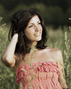 Young woman portrait smiling in nature Royalty Free Stock Photography