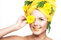 Young woman portrait of with yellow flowers Stock Images