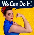 Young woman posing as working girl like the original poster of Rosie the Riveter, year 1943 Stock Image
