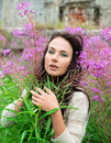 Young woman posing among the flowers beautiful Stock Photography