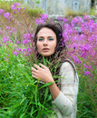Young woman posing among the flowers beautiful Royalty Free Stock Photography