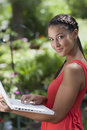 Young Woman Posing with a Laptop Outdoors Stock Images