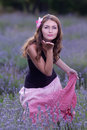 Young woman posing outdoors attractive girl field blossoming lavender Stock Image