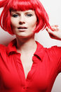 Young woman posing in red dress. Royalty Free Stock Photo