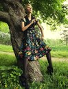 Young woman posing on a tree fashion Stock Photo