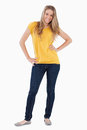 Young woman posing with a yellow shirt Royalty Free Stock Photo
