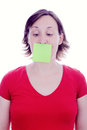 Young woman post it note on her mouth cover Stock Photos