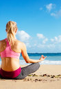 Young woman practicing morning meditation fitness in nature at the beach Stock Images